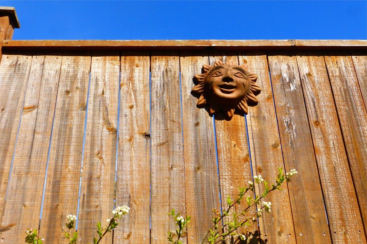 spring garden, garden, sun, clay sun, smiling sun, garden sun, smiling garden sun, blue sky, fence