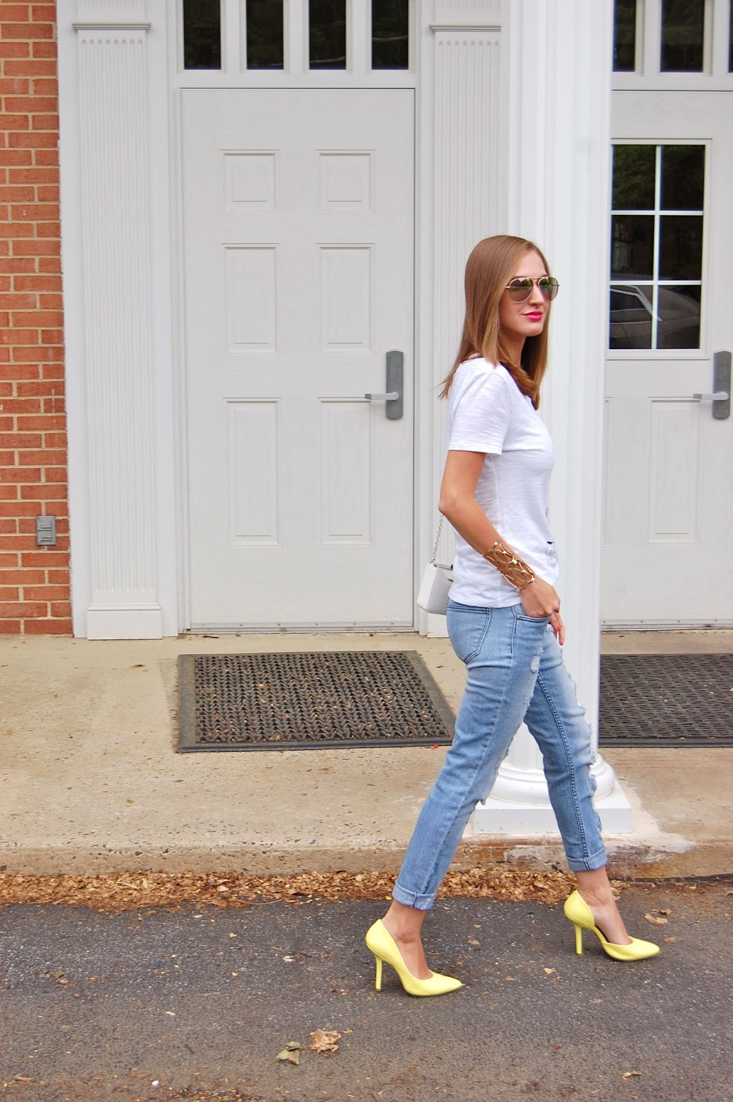 Wearing Kohl's Elle slubbed graphic tee, Nordstrom distressed boyfriend jeans, Yellow Bcbg paris Jaze d'Orsay heels, Forever21 gold scalloped cuff, Bcbg Maxazria lucite clutch