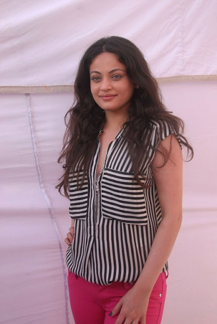 Real Life pictures of Actress Sneha Ullal without Makeup in Red pants and Sleeveless jacket