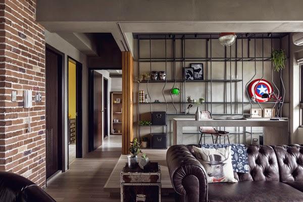 piso de estilo industrial decoración interiores sofá chester cuero y pared papel imitando ladrillos