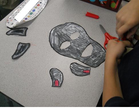 Some of the masks I used popsicle sticks as handles. For bigger masks ...