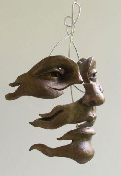 Michael Alfano esculturas de corpos rostos surreais bronze cobre Varrida pelo vento