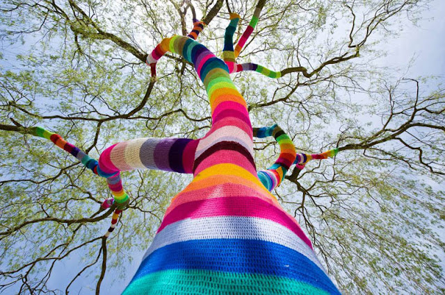 yarn bombing tree trunk branch yarn bomb