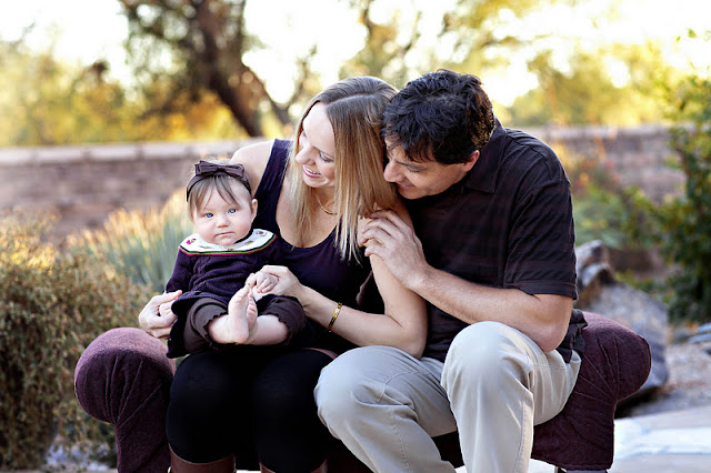 Candid shot of Tucson parents with baby during family photo session