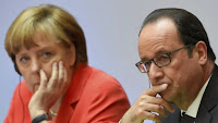 German Chancellor Angela Merkel and French President Francois Hollande attend the Petersberg Climate Dialogue conference in Berlin, Germany, May 19, 2015. (Credit: Reuters/Tobias Schwarz/Pool) Click to Enlarge.