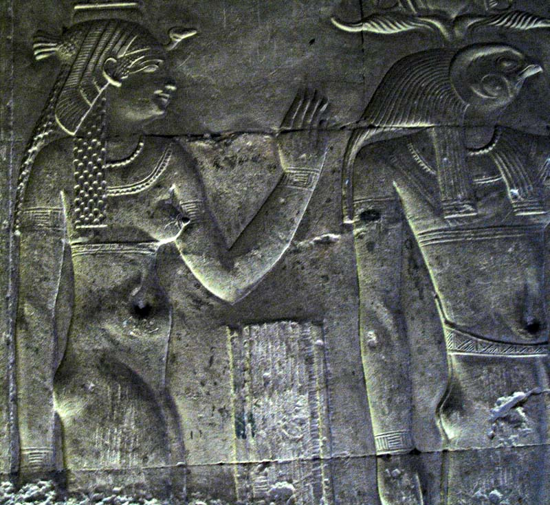 figurines carved on temple walls in Edfu in Egypt