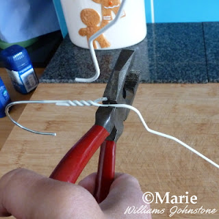 Use wire cutters to snap through a clothes hanger