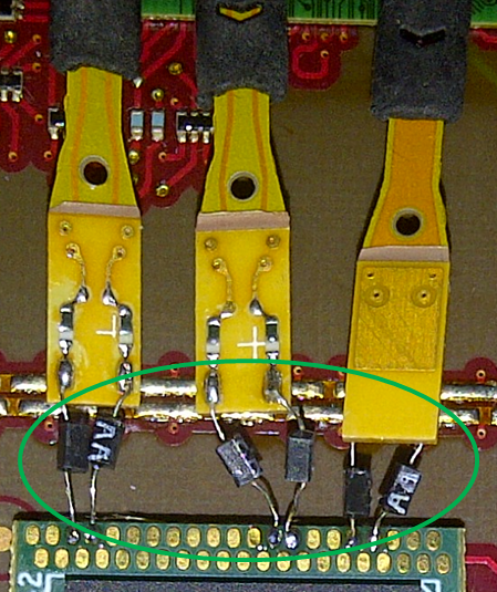 Damping resistors on solder-in probe tips  terminating at chip interposer