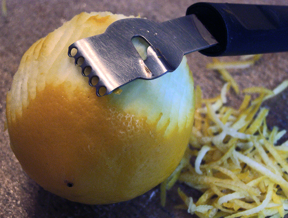 Closeup of Lemon Zester and Zested Lemon