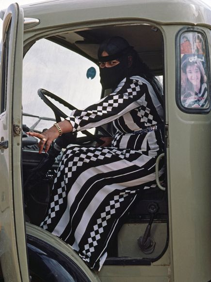 Patterns worn by Bedouin woman driving her truck in the desert via