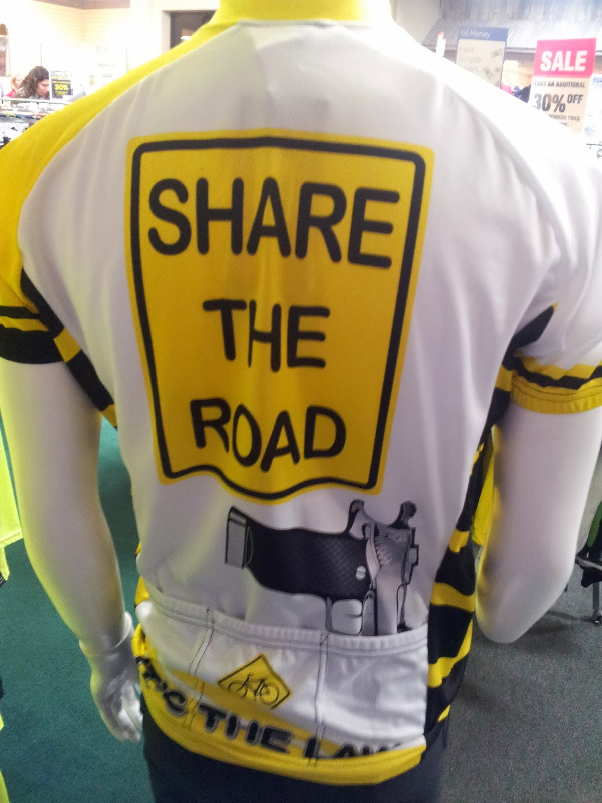 Share The Road Jersey with Handgun pointing into back pocket
