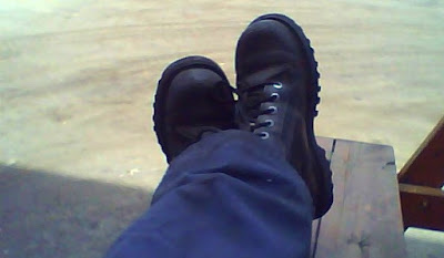 Workboot selfie cross-legged and kicking back