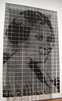 Black and white pixel portrait of a woman, very large