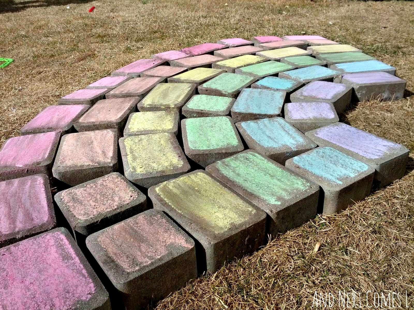 Close up of giant chalk rainbow from And Next Comes L