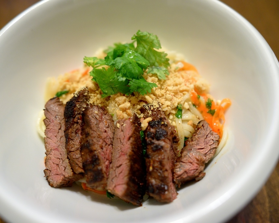 paper and plates: Firecracker Beef on Rice Noodle Salad