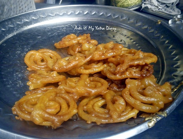 A tray full of plump jalebis at Old famous Jalebiwala - Chandni Chawk street food, Delhi