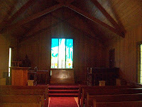 Church window illuminates the aisle