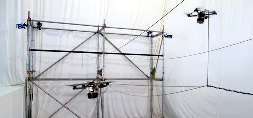 Watch as Quadrotor Drones Build A Rope Bridge