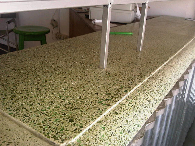 Glass cruncher crushed glass table tops and counters for Crushed glass countertops