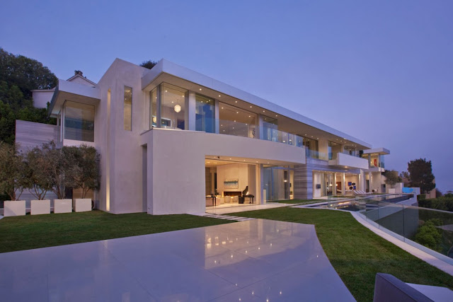 Back facade of modern home at the dusk