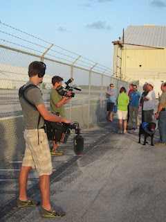 Shot of the sound guy shooting the puppy raisers and pups watching the helicopter. Photo by Carolyn Hersh.