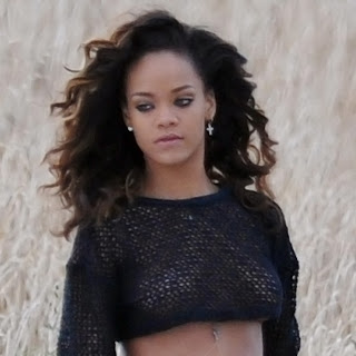 Rihanna sexy in see through top and topless while filming a music video in Ireland