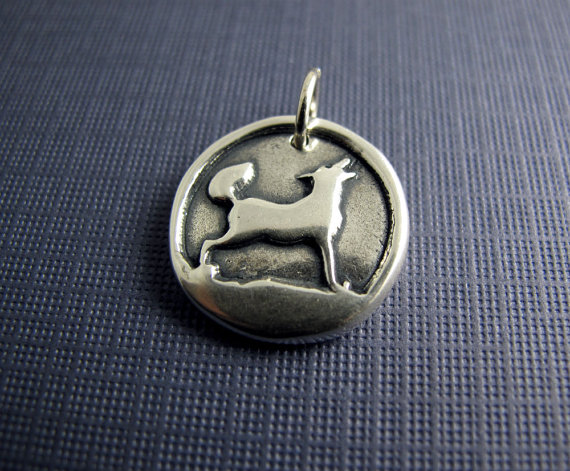 sterling silver wolf pendant charm beth hemmila hint jewelry women run wolves