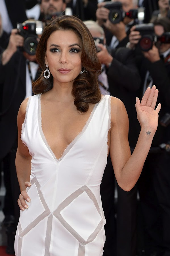 EVA LONGORIA waves to photpographers at Cannes Film Festival 2012
