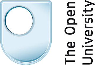 The Open University, a blue shield shaped logo with a round hole offset to the top left and wording running bottom to top on the right hand side.