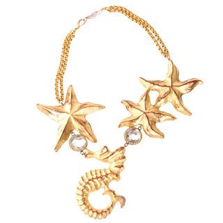 Vintage 1960's Yves Saint Laurent gold starfish and seahorse necklace.