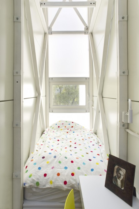 Picture of single bed by the small window in the bedroom of the narrowest house