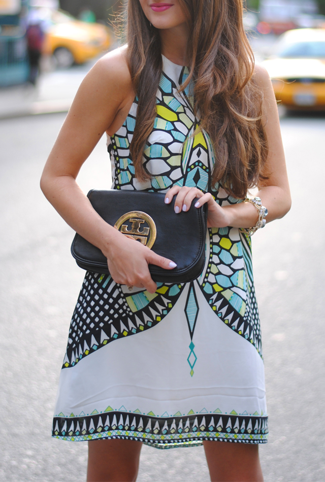 Aztec print dress, Tory Burch clutch. Perfect.