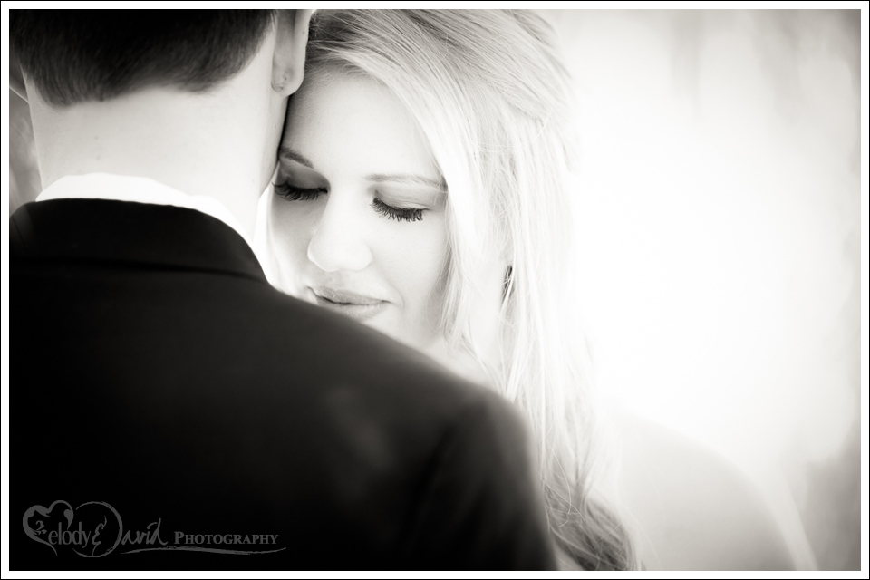 Bride and groom share a moment during the first look, black and white