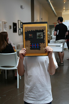 child holding artwork