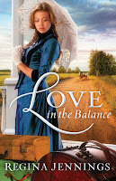 cover of Love in the Balance by Regina Jennings shows a fashionable lady in a blue dress holding a white parasol surrounded by trunks standing on a porch while a wagon approaches on a dirt road