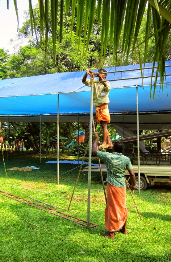 Workers putting up a canopy