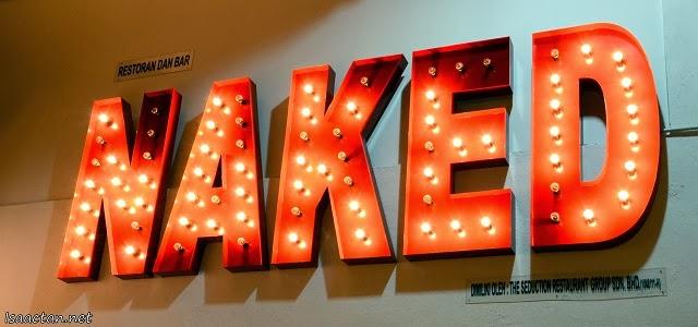 The 'moulin rouge'-like signage of NAKED Restaurant & Bar