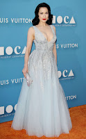Dita Von Teese is glamorous in a plunging gown at the 2015 MOCA Gala in LA