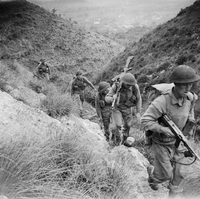 Members of the 10th Battalion, Royal Berkshire Regiment climbing the heights of Calvi Risorta in the invasion of Italy, October 1943.