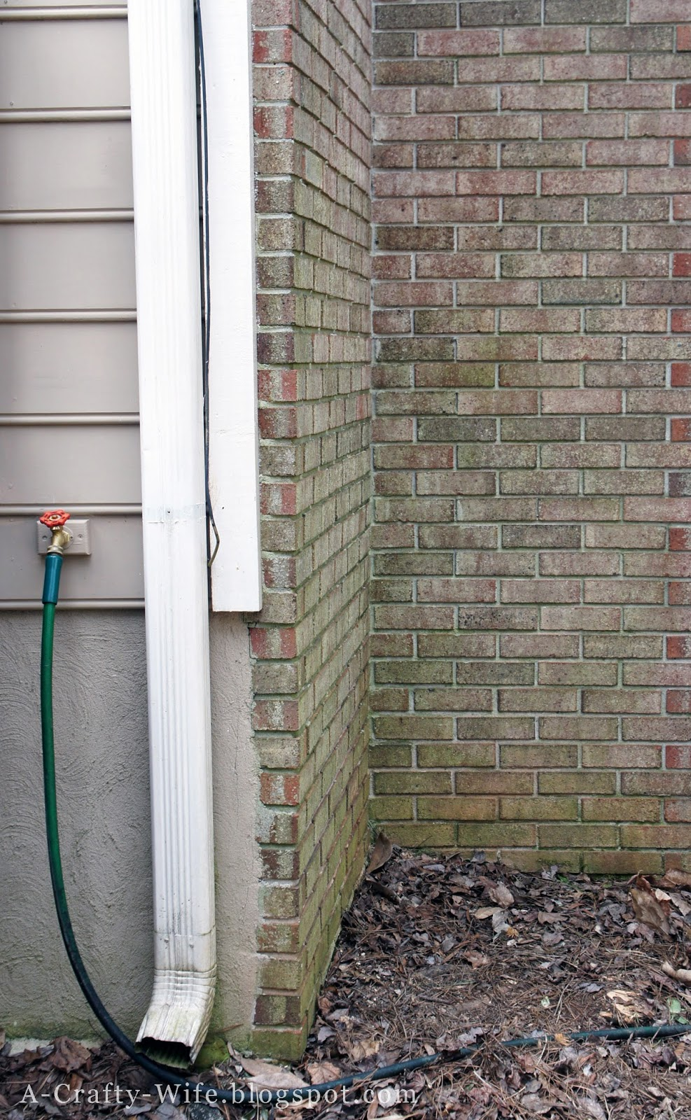Location for rain barrel near gutter downspout | A Crafty Wife