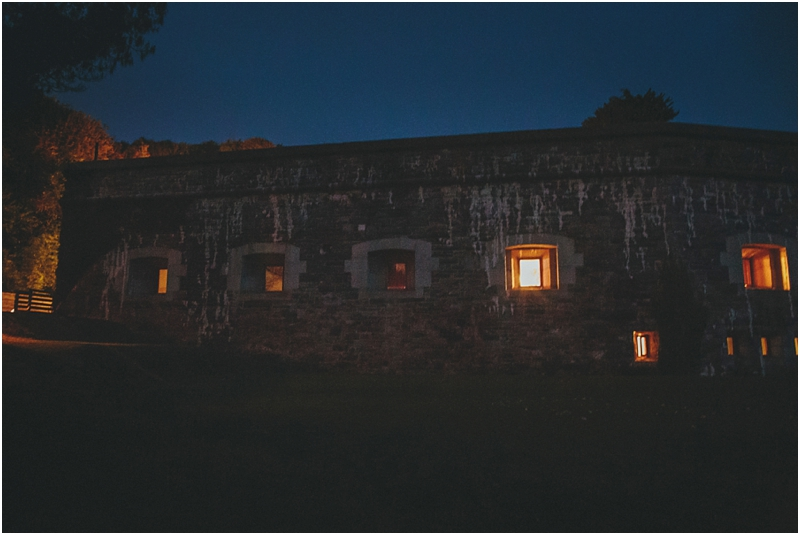 Exterior view of Polhawn Fort in the darkness