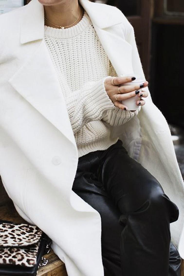 Cozy knitwear, leather trousers, cream overcoat