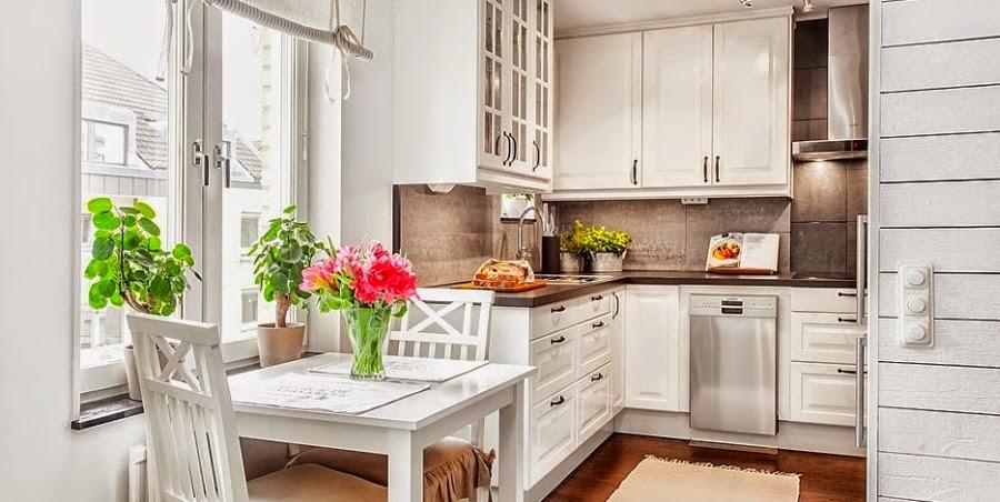 kawalerka, małe wnętrze, salon, sypialnia, białe wnętrze, kanapa, styl skandynawski, kuchnia, jadalnia, biały stół