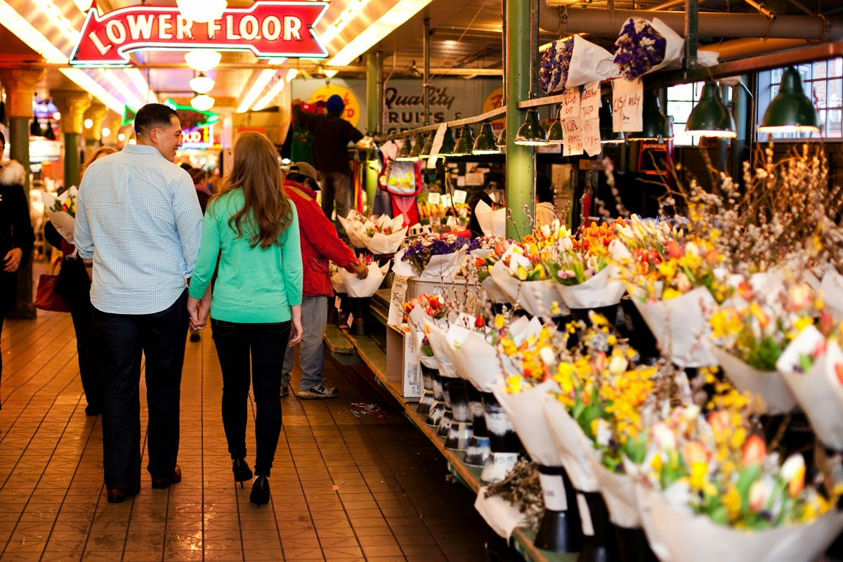 Johnny and Christina walk hand in hand at Pike Place Market - Patricia Stimac, Seattle Wedding Officiant