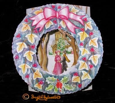 3D pop up Christmas cards by UK artist Ingrid Sylvestre Greeting Cards designer Three Dimensional Cards for Christmas and other occasions Fully 3 dimensional paper engineering cards pop out when opened Victorian Skaters Wreath traditional historical snow scene with church and Victorian costumed figures skating Ingrid Sylvestre North East artists UK