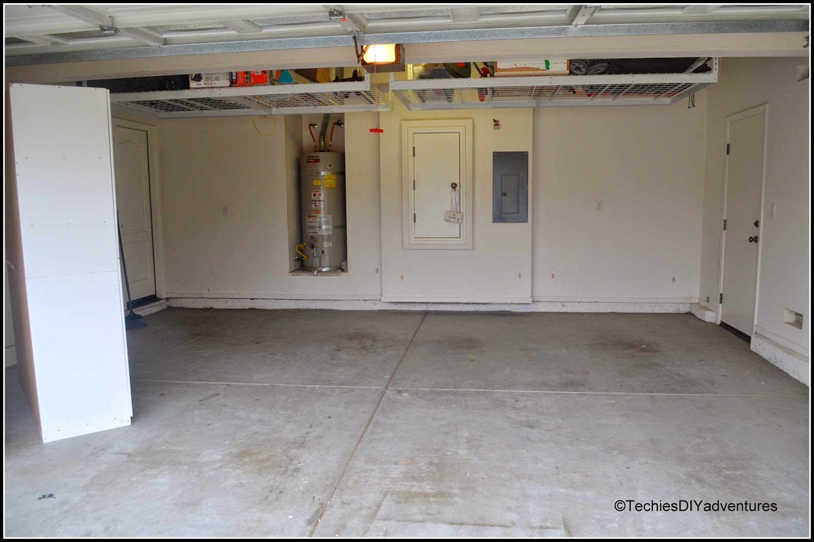 Garage floor gets a makeover with epoxy techie 39 s diy for How to clean garage floor