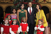 The Obama family poses with Santa's elves at the 'Christmas in Washington' .