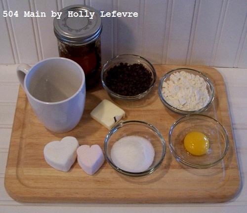 Ingredients to microwave a fudge cake in a mug