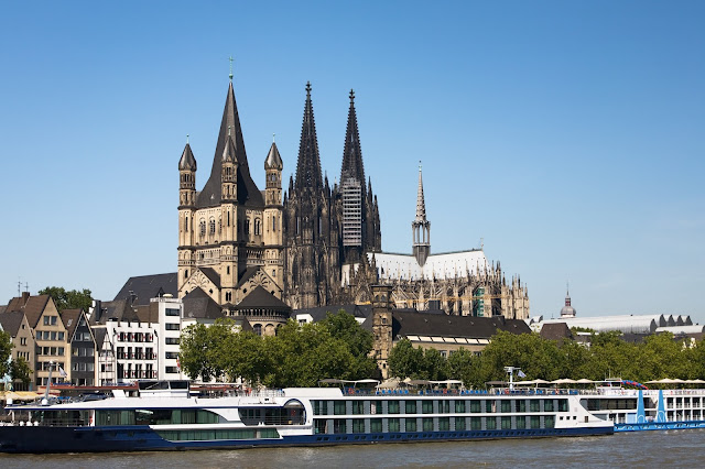 Cologne, Germany, and its mighty cathedral or Dom in the background.