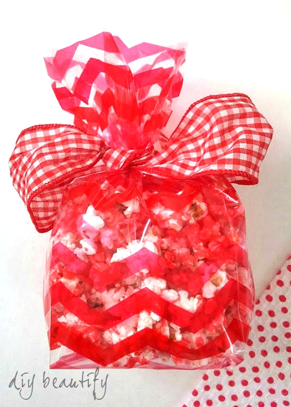 cinnamon candy popcorn in cellophane bag with gingham ribbon